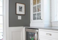 A beverage center flanked the new range along the north wall of the kitchen ....love #paint #trim #cabinets