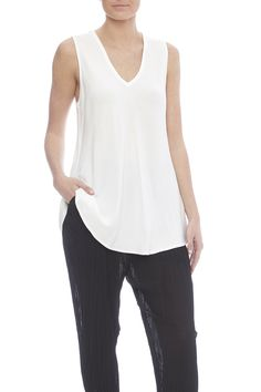 White sleeve top with a perfect bias cut and v-neckline.   Ifran Top by Jules of Morocco. Clothing - Tops - Tees & Tanks Clothing - Tops - Sleeveless Portland, Oregon