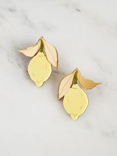 Striking yet elegant handmade statement studs with acrylic lemons and leaves. Wear the essence of a Mediterranean summer with our Garden Collection. Silver Necklaces, Sterling Silver Earrings, Silver Ring, Lemon Bridesmaid Dresses, Miss Moss, Laser Cut Acrylic, Wolf Moon, Chunky Jewelry, Decoration
