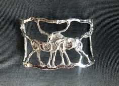One of a kind solid sterling silver bracelet with two horses cast with the lost wax method by Marcela Ganly Two Horses, Sterling Silver Bracelets, Belt Buckles, Cuff Bracelets, Wax, Cuffs, Lost, Arm Warmers, Belt Buckle