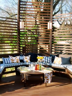 Stylish deck with privacy screen; perfect for entertaining. http://www.hgtv.com/entertaining/13-party-ready-outdoor-spaces/pictures/page-5.html?soc=pinterest