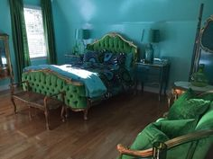 Found on EstateSales.NET: The most stunning bedroom ever. Like EVER! Queen bed from Fabulous & Baroque in Dallas, TX - hand carved, ornate mahogany showpiece covered in rich, emerald green velvet. Absolutely AMAZING!