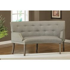 The Hilton Curved Graphite Loveseat    The look of reclaimed wood highlights this Hilton curved loveseat. This furniture features a weathered grey oak finish and graphite linen-look upholstery....