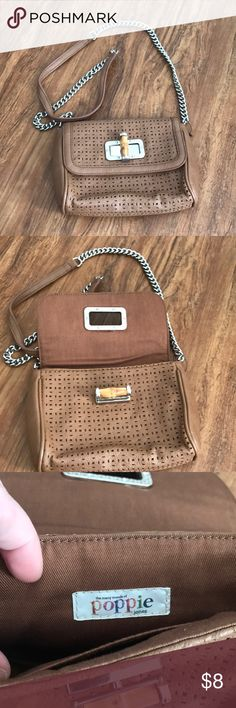 Tan Crossbody Bag Tan Crossbody Bag with silver hardware and bamboo enclosure. Cut outs across exterior. Never used Poppie Jones Bags Crossbody Bags