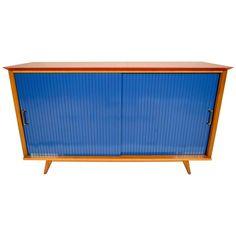 Beautiful 1960s Danish Mid-Century Credenza. Solid teak wood, wooden top has…