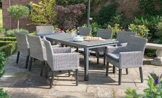 Dine in the Bretagne Collection, a classic wicker furniture choice with its contemporary design for outdoors as well as indoor dining.
