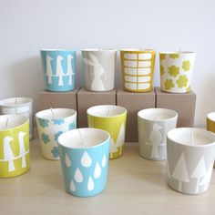 Hand Poured Soy Candles. Love the design of the votives and the color palette.