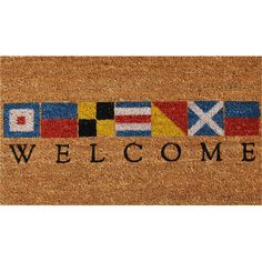 NEED THIS ONE. Featuring a flag motif, this lovely coir doormat lends a nautical touch to your beach house.  Product: DoormatConstr...