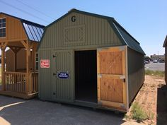 """Here is a look at our Orchard Solid Stain Barn with a Green Roof located in Winslow, AZ. This Barn also has 50"""" Metal Door Braces on it. The braces are used to support a wooden door and keep it rom sagging, making it easier to open and close. These are available on Graceland Gear. Come take a look today! See your local representative today for options on your own Graceland Portable Building®!"""