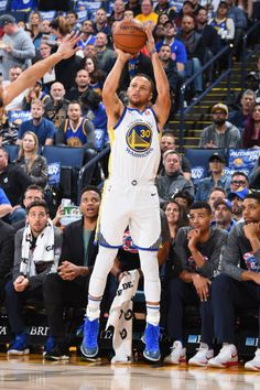 Stephen Curry of the Golden State Warriors shoots the ball against the Philadelphia 76ers on November 11 2017 at ORACLE Arena in Oakland California...