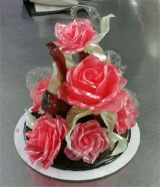 Pulled sugar roses..     someday I'll figure out how to do this