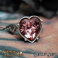 Last Chance! Alchemy Gothic AG-R198 Bower Troth Ring  An antique pink, Swarovski cut crystal heart, set in on Mediaeval-style pewter finger ring, decorated with wild roses.