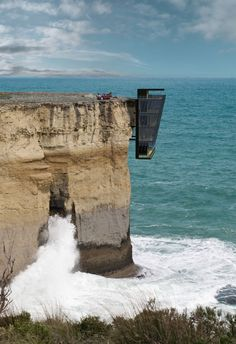 A conceptual cliff house suspended above the Australian ocean in the state of Victoria, by prefabricated architecture specialists Modscape. The entrance of the Cliff House by Modscape, Architecture Cool, Australian Architecture, Architecture Magazines, Cliff House, Ocean House, Beach House, Conceptual Design, Australian Homes, Victoria Australia