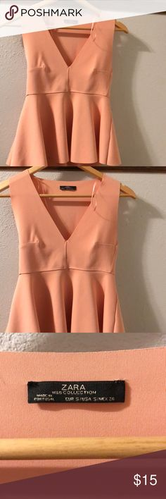 Zara Pink Peplum Top I have worn this once. It has a scuba like material. Pretty low cut in the front. Very cute and pink. Looks peach in lighting but is more of a baby pink. Zara Tops Tank Tops