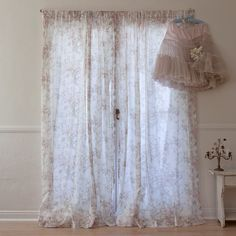 Chablis Voile Curtain from Rachael Ashwell:  Sheer voile curtains are printed in with a lovely distressed floral motif.  Available in three lengths.