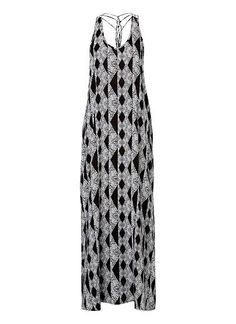 100% Viscose Rope Back Maxi. Comfortable swing fitting silhouette features a dipped v-neck, rouleaux knotted straps at back complete with side splits in an all over Ikat print. Available in Multi as seen below.