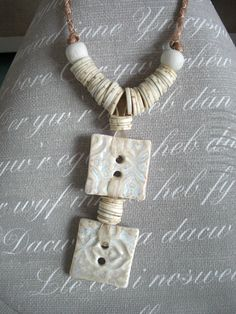Aztec lace ceramic button necklace on organza ribbon cord, caramel, tan, brown, natural, cream, white. £25.00, via Etsy.