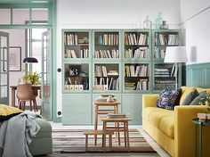 Create a calm living room in green, grey and yellow. Green BESTÅ closed cabinets create space for all your stuff and the VIMLE sofa in yellow allows you to sit back and relax.