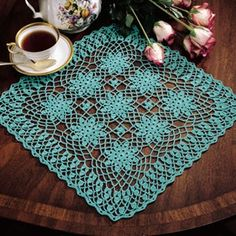 """Lace Bouquet Doily Thread Crochet ePattern - For a refreshing change of pace, replace that traditional ecru or white doily with a soothing pastel. A bouquet of lacy floral motifs graces this stunning design which is crocheted using bedspread weight cotton thread (size 10) and a size 6 (1.80 mm) steel crochet hook. Number of Designs: 1 Approximate Design Size: 16-1/2"""" square"""