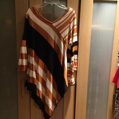 Striped cute asymmetrical top small will fit M too NY Collection Asymmetrical orange, white and black. Will look great with jeans or leggings. Good condition. Smoke free home. NY Collection Tops