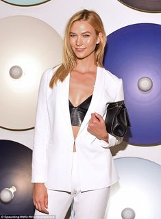 Flirty fashion: Karlie Kloss flashed a hint of her black leather bralet while attending the Boss Womenswear SS/17 fashion show in Manhattan on Wednesday