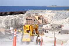 The Herbert Hoover Dike consists of a 143-mile embankment system surrounding Lake Okeechobee.  The Jacksonville District is working to reduce the risk of embankment failure by installing a cutoff wall, along with the removal and replacement of water control structures (culverts) around the lake. In addition, a comprehensive system wide study is ongoing to identify and prioritize additional risk reduction features to help ensure the safety of south Florida residents.