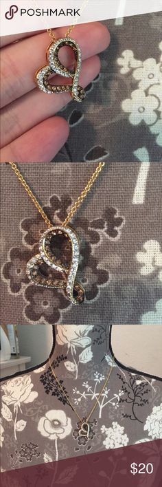 Diamond heart necklace Never worn (gift from someone). Beautiful gold chain, white diamonds, and chocolate diamonds, gold structure. Honestly not sure if the chain is solid gold, but it does have 18 K engraved. The pendant has 18K engraved as well, though I do not think it is 100% gold. unknown Jewelry Necklaces