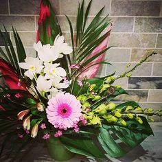 A #cute and #simple arrangement with #cymbidium and #dendrobium orchids paired with a #gerbera, fillers and greenery!