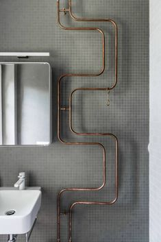 Gray tiled bathroom, exposed copper pipes by Karhard, Berlin | Remodelista
