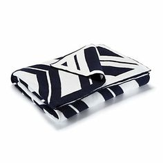 Just bought! Navy and pearl Throw Blanket for $128 on C. Wonder; also in gray...