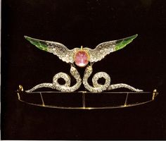 ARTHUR AND CARLO GUILIANO GOLD TIARA ca. 1900. old tiara made to resemble the ancient egyptian amulet winged globe. Set with diamonds and set in green enamel, the globe is represented by a star ruby.