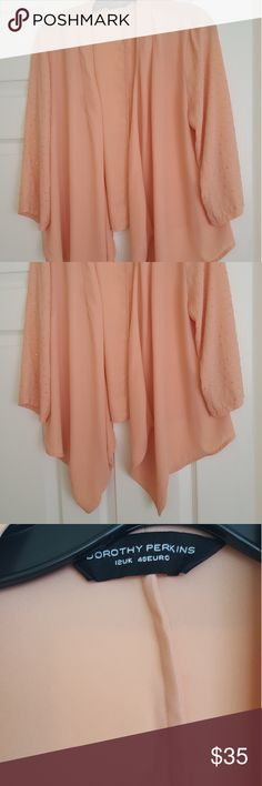 Dorothy Perkins coral peach chiffon cardigan top Beautiful peach chiffon drape cardigan/blouse top with tiny gold details all over arms. Longer in the front. Great condition (there is a tiny speck on fabric shown in photo but not noticeable at all). Great with a tank and jeans or dressed up with a simple dress! UK size 12= US size 8 Dorothy Perkins Tops Blouses