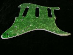 GUITAR PICKGUARD - GREEN PEARLOID - REPLACEMENT UNIVERSAL Stratocaster FIT by EDMBG. $3.99. BRAND NEW - REPLACEMENT PICKGUARD for ELECTRIC GUITARS! COLOR: GREEN PEARLOID DELUXE 4-LAYER GUARD features White base layer, Black layer, White layer, then topped with the colored pearloid. Will fit most standard electric Guitars with 3 single coil pickup holes. Shielded Foil layer to prevent buzz is already attached to the volume / tone control area under the pickguar...
