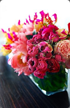 Vibrant floral arrangement of mixed blooms by adrianne smith floral design