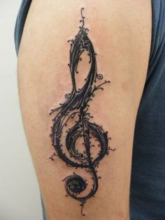Treble clef @ Resurrection Tattoo & Body Piercing