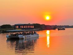 Sail along the Zambezi River on a sunset cruise. This picture doesn't do the African sunset justice. Picture all the colours from orange to red and that is what you will experience. David Livingstone, Cruise Offers, African Sunset, Victoria Falls, Autumn Activities, Get Directions, Us Travel, Day Trips, Safari