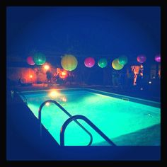 String lanterns over the pool!  Consider using nylon lanterns since paper starts to dissolve when it gets wet, plus nylon colors are brighter: http://www.partylights.com/Lanterns/Nylon