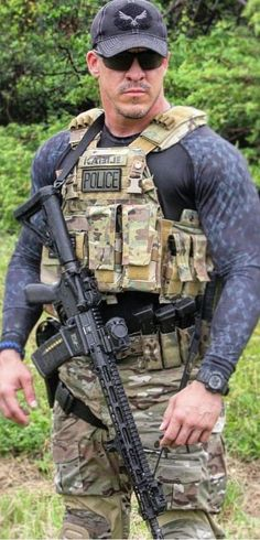 Complete Armalite Semi Automatic Assault Rifle Buyer's Guide - Clara Hot Army Men, Sexy Military Men, Cop Uniform, Men In Uniform, Military Special Forces, Hot Cops, Muscles In Your Body, Muscular Men, Raining Men