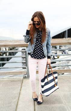 Navy and white polka dot top, pale pink pants, jean jacket, and striped tote