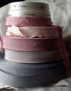lush beautiful black on bone double faced satin ribbon...Amour  perfect for wedding invites and decor or that gift wrapping for that special someone!!  mix it with my new amazing grosgrains and dupioni silks...OMG, I have died and gone to ribbon heaven!!!  measures 5/8 wide, this listing is for one yard of the Amour ribbon, just change the quantity if you need more  also available on a spool in 1/2 yard increments  customized phrases/sayings available
