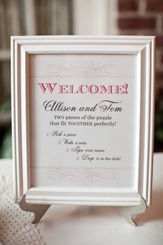 Custom sign for welcome table with puzzle piece guest book via allisonbarnhilldesigns on WedOverHeels