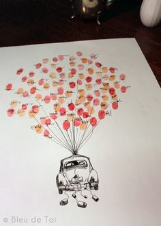 I really like this for a guest book, but to make it personal you could insert whatever kind of vessel you wanted instead of the VW. Mine would be a hot air balloon basket with Nate and I inside...too cute!