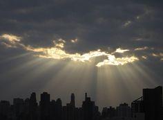 cloud break over city