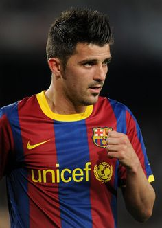 THE Striker, David Villa - BARCELONA FC  only repinning this because he plays for spain...HALA MADRID