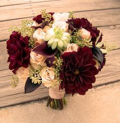 Bouquet of quicksand roses, burgundy dahlia and succulents--beautiful