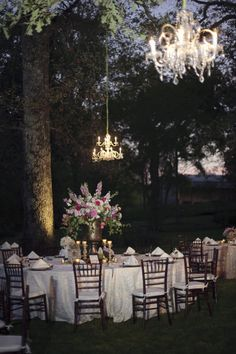 chandeliers hanging from the trees gets us every single time Photography by Shane Snider Photography / shanesnider.com/, Florals by http://www.ilovetulip.com/pages/about-lesley