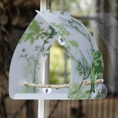 """bird feeder that attaches to window - I could make this :) picturing the sides and bottom of a gallon milk jug, dovetail cuts to join at the top. Nice to pair with a book about local birds & make our own """"field guide"""""""