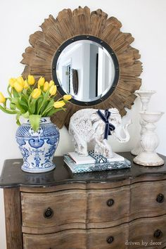 A white wooden elephant from HomeGoods is the star of the show on our foyer console that's decorated for spring! (sponsored pin)