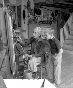 "Norman Rockwell in his studio with model Hank Bergmans examining the painting ""Can't Wait,"" about 1970, Norman Rockwell Museum. Courtesy Smithsonian American Art Museum."