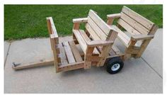 Pull behind mower riding trailer.